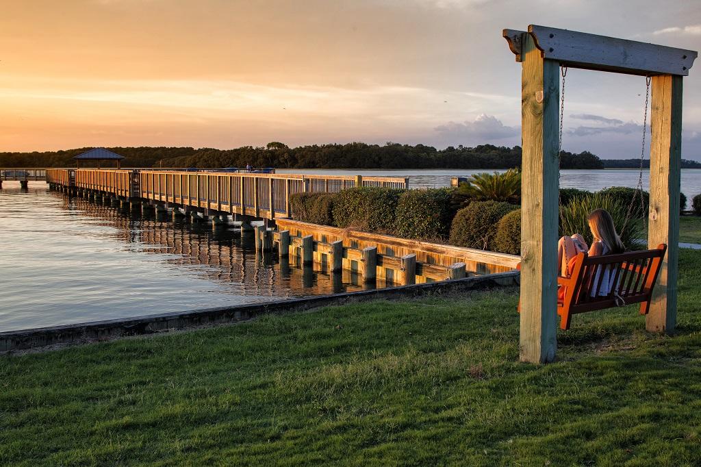 hilton head island spinnaker resorts bluewater resort view bluewater dock girl on swing sunset