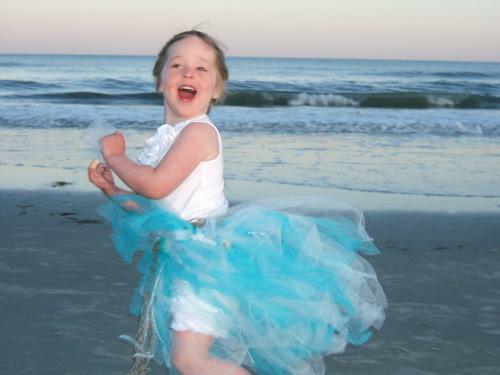 little girl blue dress on beach