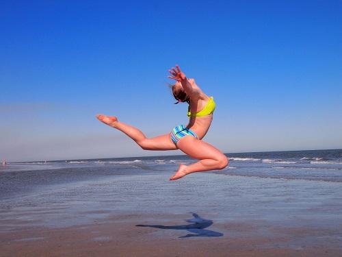 ocean jumping beach activities spinnaker resorts blog
