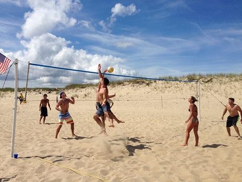 beach volley ball image spinnaker resorts fitness center summer 2018 beach fitness tips running header